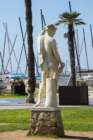 SITGES, CATALONIA, SPAIN - SEPTEMBER 29, 2016: Statue of a man in Sitges Editorial