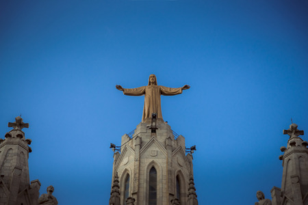 Barcelona, Catalonia, Spain. Jesus Christus Statue (by Josep Miret) at Temple Expiatori del Sagrat Cor on Summit of Mount Tibidabo in Barcelona.