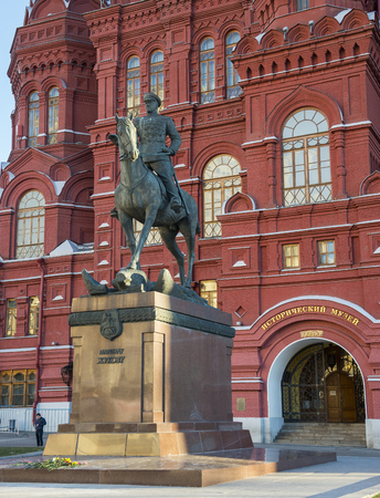 marshal: MOSCOW, RUSSIA - DECEMBER 28, 2015: Monument to the marshal Zhukov against the building of the Historical museum, Moscow