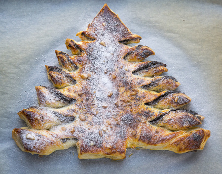 substrate: Christmas Tree of puff pastry with poppy and icing sugar Stock Photo