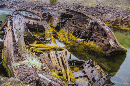 Ships graveyard in the water of the Barents Sea, Teriberka, Russia.