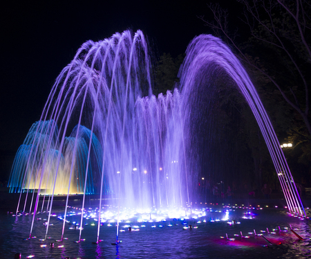 Fountains with colorful illuminations at night. Krasnodar, Russia Stock Photo