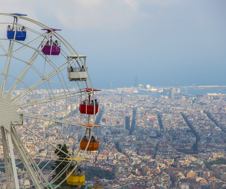 spanish architecture: BARCELONA, CATALONIA, SPAIN - OCTOBER 02, 2016: Top view on the Amusement park with the views of Barcelona city