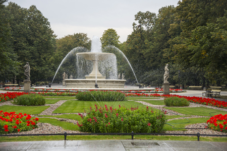 WARSAW, POLAND - SEPTEMBER 28, 2016: Fountain in the Saxon Garden. It was established in 1855. The fountain is the centrepiece of gardens designed by the 19th-century designer Henryk Marconi and also one of the most precious urban symbols of Warsaw