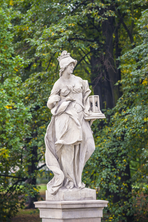 allegoric: Sandstone statue in the Saxon Garden, Warsaw, Poland. Allegorical depiction of History. Made before 1745 by anonymous Warsaw sculptor under the direction of Johann Georg Plersch Stock Photo