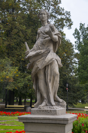 Rococo sculpture in the Saxon Garden, Warsaw, Poland. Allegorical depiction of Glory. Made before 1745 by anonymous Warsaw sculptor under the direction of Johann Georg Plersch Stock Photo