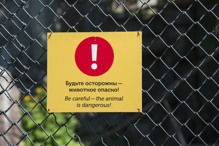 MOSCOW, RUSSIA - JUNE 26, 2016:  Warning or prohibiting labels in Moscow Zoo Editorial