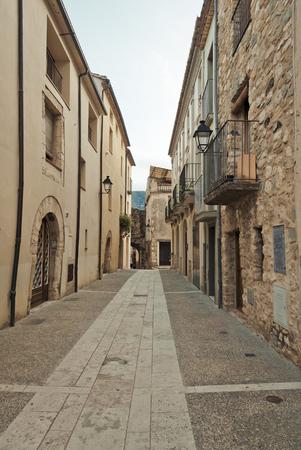 Narrow old street in medeival town of Besalu, Spain