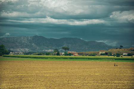 ration: Landscape with field and houses in Spain