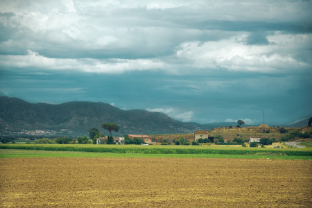 Landscape with field and houses in Spain
