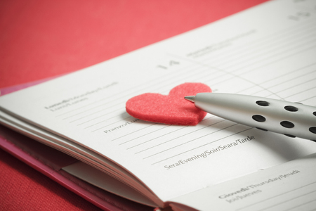 Preparation for St. Valentines Day. Notes in a notebook on the day of St. Valentine Stock Photo