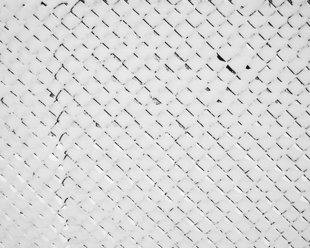 Winter background. Close up of fence wirecloth covered with snow Stock Photo