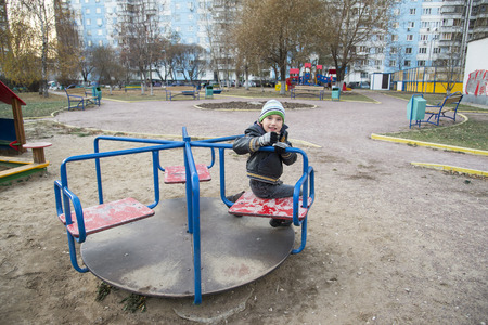 Boy on the playground in winter. Moscow