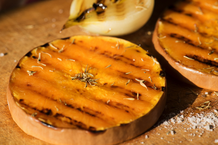 Pumpkin slices grilled with herbs