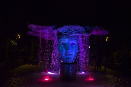 ODESSA  UKRAINE - SEPTEMBER 23, 2018: Sculpture The Beginning of Time in the Greek park, a fountain with illumination at night