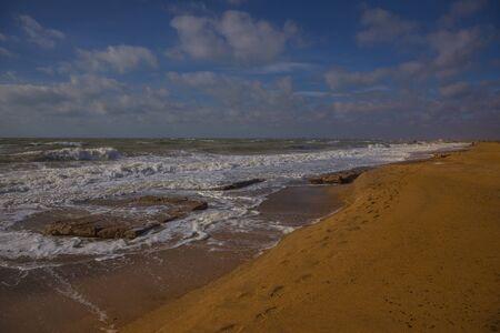 Waves on the Black Sea, sandy beach in the area of Yevpatoriya. Crimean peninsula