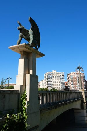 A gargoyle at the entrance to the bridge. Puente del Reino - One of many bridges over former Rio Turia river