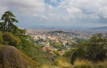 Beautiful view of Barcelona city in hot summer day, Spain