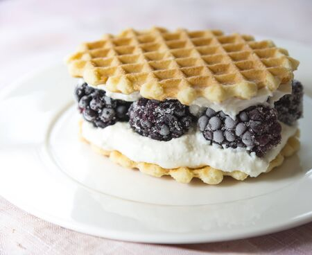 Golden waffles with blackberries and cream cheese