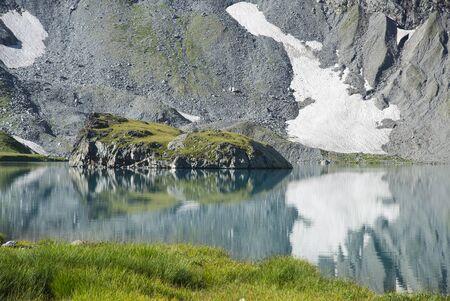 Summer day in Caucasus mountains, Karachay-Cherkess Republic. Mountain lake Stock Photo