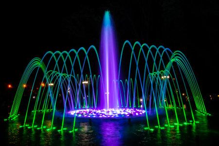 Illuminated colorful fountains. Krasnodar, Russia 版權商用圖片