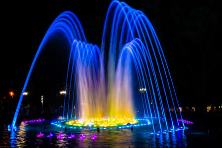 Fountains with colorful illuminations at night. Krasnodar, Russia 版權商用圖片