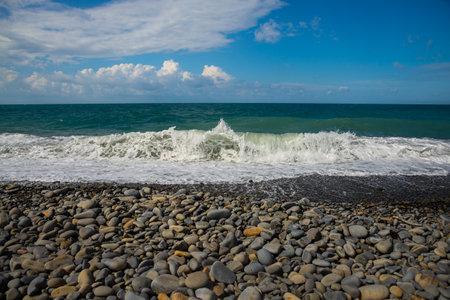 Deep sea water waves. Pebble beach on the Black Sea coast