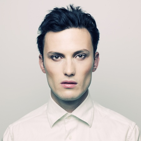 Fashion portrait of a handsome young man with make-up Stock Photo