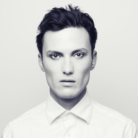 Fashion portrait of a handsome young man with make-up photo