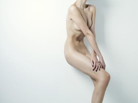 Fashion photography of nude elegant lady on white background Stock Photo - 9970318