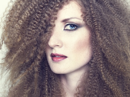 redhead: young beautiful woman with magnificent curly hair