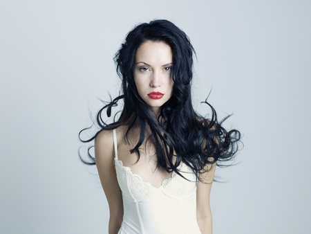 Photo of young beautiful lady with magnificent dark hair photo