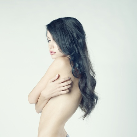 nude female figure: Fashion photo of beautiful nude woman with long dark hair
