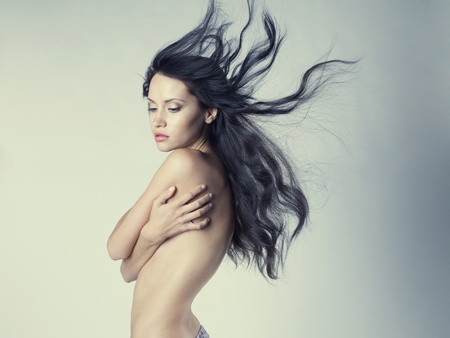 nude female figure: Fashion photo of beautiful nude woman with magnificent hair Stock Photo