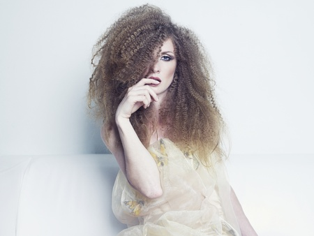 bewitch: Photo of young beautiful woman with magnificent curly hair Stock Photo