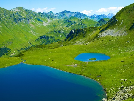 Landscape with a large lake in the Caucasus Mountains photo