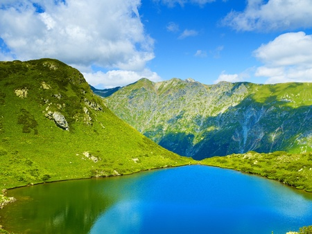 blue ridge mountains: Landscape with a large lake in the Caucasus Mountains Stock Photo