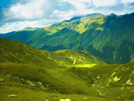 Mountain panorama from alpine meadows in the Caucasus Mountains photo