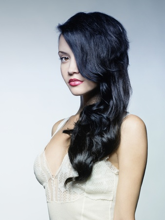magnificent: Photo of young beautiful lady with magnificent dark hair Stock Photo