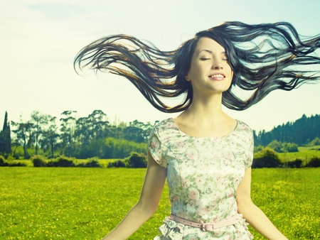 Portrait of a beautiful lady in a flower meadow Stock Photo