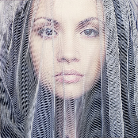 Portrait of beautiful young woman under a veil