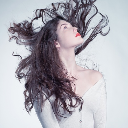 hair wind: Photo of young beautiful woman with magnificent hair  Stock Photo