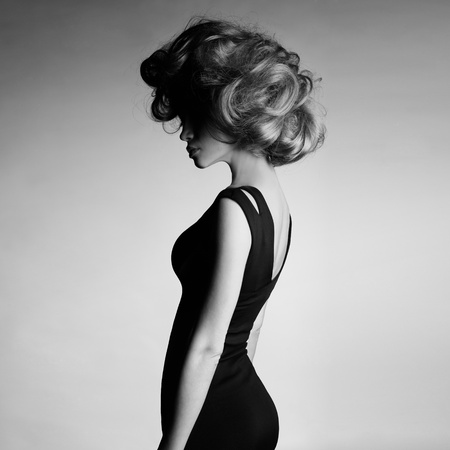 Fashion photo of young lady in elegant black dress
