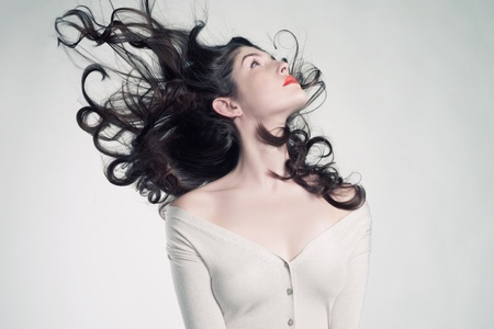 windblown: Photo of young beautiful woman with magnificent hair
