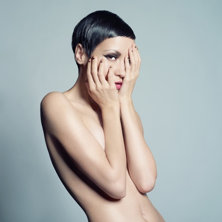 Portrait of beautiful nude lady with short hair photo