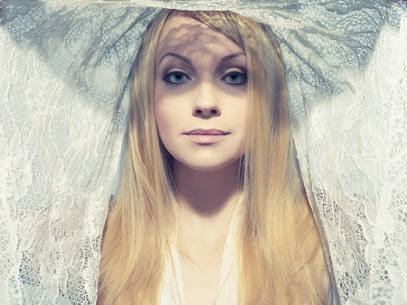 Portrait of beautiful young woman under a veil Stock Photo - 12590283
