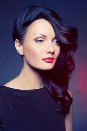 Fashion portrait of beautiful lady with elegant hairstyle photo