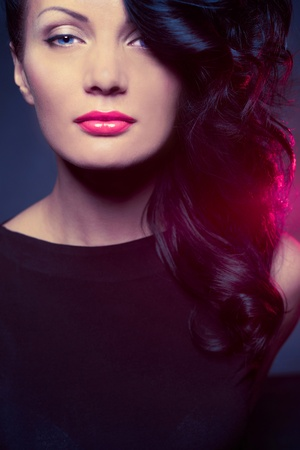 Fashion portrait of beautiful lady with elegant hairstyle