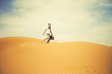 Fashionable men running through the desert photo