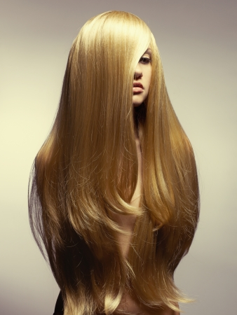 Photo of young beautiful woman with magnificent hair photo